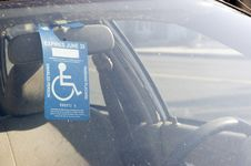 Free Handicap Sign On A Rear View Mirror Royalty Free Stock Photo - 15163045