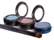 Three Eyeshadows And Brush Stock Photo