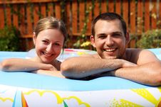 Pair Bathes In Inflatable Pool Stock Photos