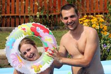 Pair Bathes In Inflatable Pool Royalty Free Stock Photo