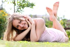 Free Young Female Lying On Grass Field Stock Photo - 15164500