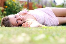 Free Young Female Lying On Grass Field Stock Photography - 15164502