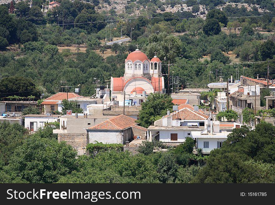 Small cretan village with church