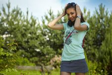 Free Young Beautiful Girl With Earphones Walking. Stock Images - 15170734