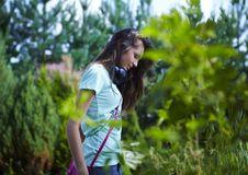 Free Young Beautiful Girl With Earphones Walking. Stock Photo - 15170760