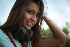 Free Young Beautiful Girl With Earphones Smiling. Stock Photos - 15170863