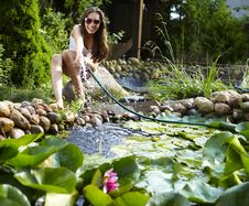 Free Young Happy Girl With Garden Streamlet Near Pond Royalty Free Stock Image - 15171436