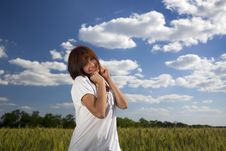 Free Female Smiling Against Blue Sky And Wheat Fie Stock Photo - 15171960