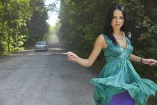 Girl In The Road On Summer Dres. Stock Photography