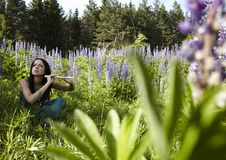 Free Attractive Girl With Flute Sitting In Summer Field Stock Images - 15172214