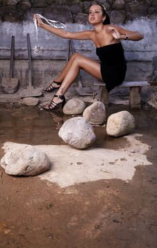 Sexual Girl In Black Dress Inside Stone Quarry Stock Photography