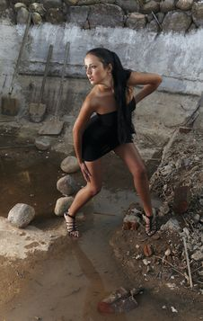 Sexual Girl In Black Dress Inside Stone Quarry Royalty Free Stock Photography