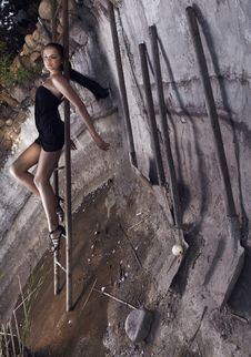 Free Sexual Girl Laying On A Rusty Ladder Of Leader Stock Images - 15172604