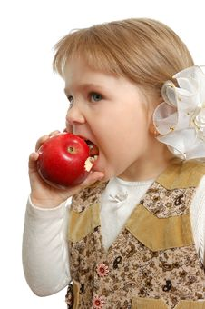 Free The Little Girl Biting An Apple Royalty Free Stock Image - 15173066