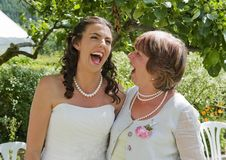 Bride And Her Mother Enjoying A Quiet Moment Stock Photos