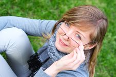 The Person Of The Young Girl In Glasses Stock Photo