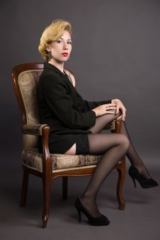 Woman In A Business Suit Sits In An Armchair Stock Images