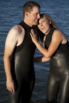 Couple Close Wet Suit Stock Photography