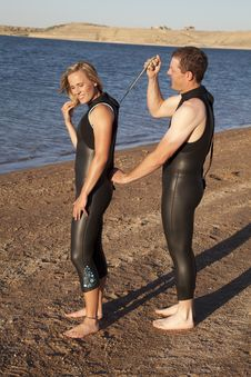 Helping Wet Suit Stock Image