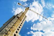 Construction Cranes And Unfinished House Royalty Free Stock Images