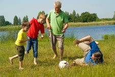 Free Family Playing Soccer On The Grass Royalty Free Stock Image - 15183656