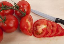 Free Tomatoes On Chopping Board Royalty Free Stock Image - 15189456