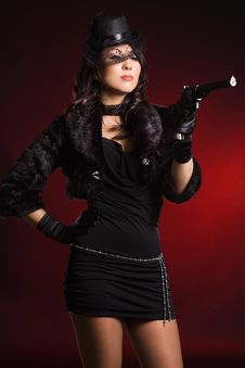 Free Elegant Lady With A Pistol Royalty Free Stock Images - 15189789