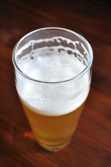 Unfinished Glass Of Beer Royalty Free Stock Photos