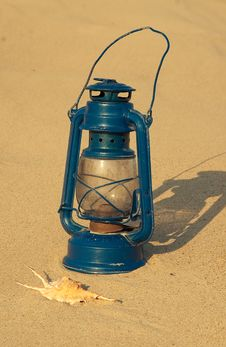 Free Old Lamp On The Sandy Beach Royalty Free Stock Image - 15194126