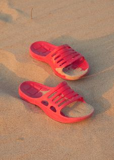Free Slippers On The Sandy Beach Royalty Free Stock Images - 15194139