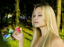 Free Blonde Blowing Soap Bubbles Royalty Free Stock Images - 15195369