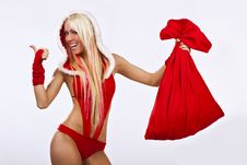 Woman In Santa Claus Suit With Gift Bag Stock Photos