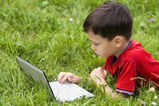 Boy Using Notebook Stock Images