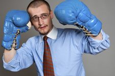 Businessman Wearing Blue Boxing-gloves Stock Photo