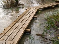 Free Wooden Bridge Through Flooded River Royalty Free Stock Photography - 1520967