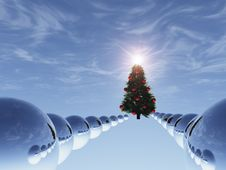 Christmas Tree In Surreal Sky Blue With Path Of Spheres Stock Photo