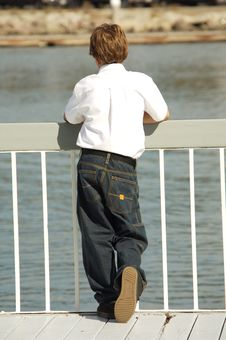 Free Young Boy On A Dock Stock Photo - 1521140