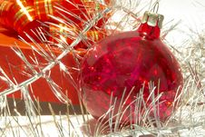Gift Box, Christmas Ball And Tinsel Royalty Free Stock Photos