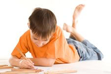 Free Boy Lying And Draw Royalty Free Stock Images - 15201089