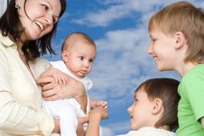 Mother With Three Children Stock Photo