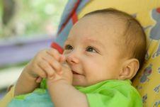 Happy Newborn Baby Lies Stock Image