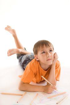 Boy Lying On The Floor Royalty Free Stock Photo