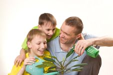 Father And Children  Watering Flower Royalty Free Stock Photography
