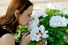Free Girl Smelling Flowers Stock Photos - 15204173