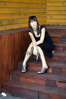 Girl Sitting On Stairs Royalty Free Stock Images