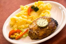 Steak Of Pork,grilled-with Salad Of Potatoes Royalty Free Stock Image