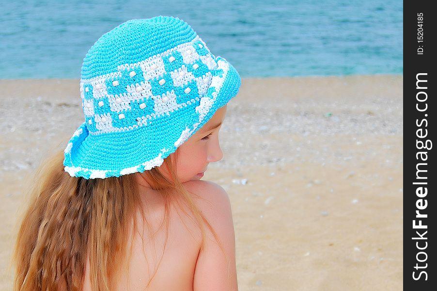 The little girl on the beach