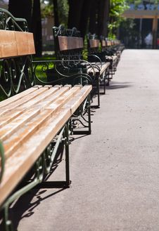 Free A Line Of Benches In Park Stock Photography - 15210842
