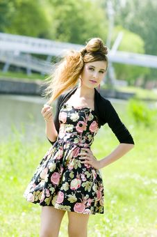 Teenager Girl Model Presenting Clothes In The Park Royalty Free Stock Photography