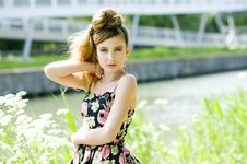 Teenager Girl Model Presenting Clothes In The Park Royalty Free Stock Image